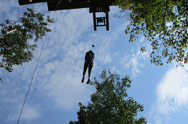 Flies through the air on zipline course