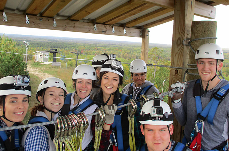 Group poses for image during brainerd zipline tour