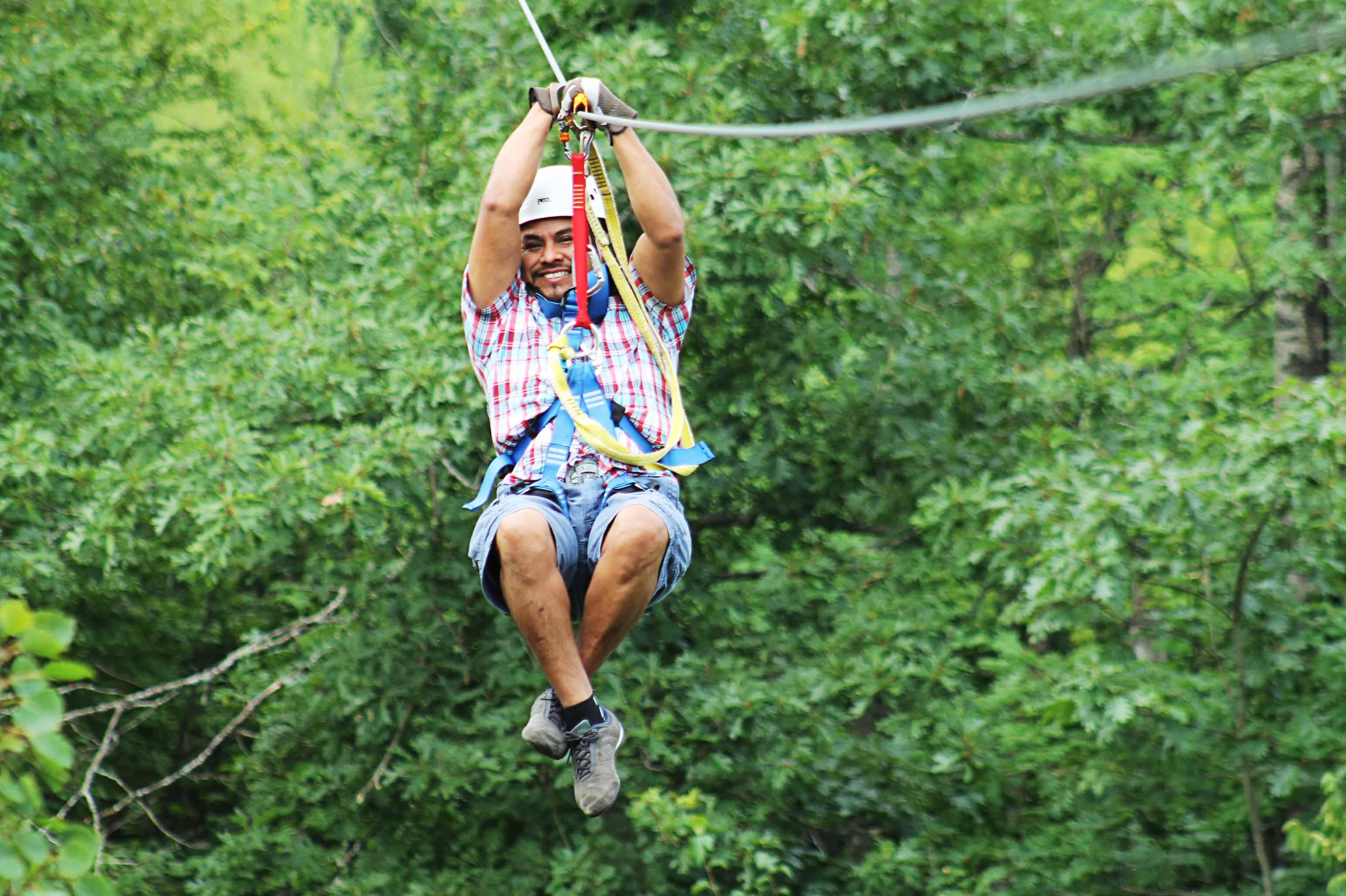 Man zips over trees on Brainerd course